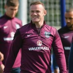England striker Wayne Rooney leads the players out for a team training session at Tottenham Hotspur Training Centre in London on September 7, 2015, ahead of their UEFA Euro 2016 qualifying football match against Switzerland at Wembley Stadium on September 8, 2015.  AFP PHOTO/GLYN KIRK  NOT FOR MARKETING OR ADVERTISING USE / RESTRICTED TO EDITORIAL USE