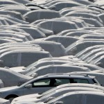 New cars of several brands of German carmaker Volkswagen AG are covered with protective covers before they are loaded for export on a transport ship at the harbour of the Volkswagen plant in Emden, Germany, April 24, 2009.     REUTERS/Christian Charisius/File photo      TPX IMAGES OF THE DAY