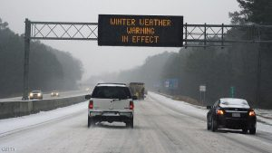 "CHAPEL HILL, NC - JANUARY 22: Vehicles move along Interstate 40 as an overhead sign indicates 'Winter Weather Warning In Effect"" during a winter storm on January 22, 2016 in Chapel Hill, North Carolina. A major snowstorm is forecasted for the East Coast this weekend with some areas getting a possible one to two feet of snow. (Photo by Lance King/Getty Images)"