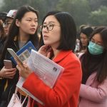NANJING, CHINA - NOVEMBER 27: Examinees prepare for the 2017 China Civil Service Examination at the exam site of Nanjing Forestry University on November 27, 2016 in Nanjing, Jiangsu Province of China. Over 1.486 million people signed up and got the qualification in the civil service examination for about 270,000 quotas this year.  (Photo by VCG/VCG via Getty Images)