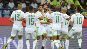 Algeria's forward Riyad Mahrez (back C) celebrates with teammates after scoring a goal during the 2017 Africa Cup of Nations group B football match between Algeria and Zimbabwe in Franceville on January 15, 2017. / AFP / KHALED DESOUKI (Photo credit should read KHALED DESOUKI/AFP/Getty Images)