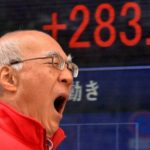 A man gives a yawn before a share prices board in Tokyo on December 18, 2013. Japan's shaer prices rose 283.60 points to close at 15,583.46 points at the morning session of the Tokyo Stock Exchange with a strong lead from Wall Street and as the weaker yen gave exporter shares a lift.    AFP PHOTO / Yoshikazu TSUNO        (Photo credit should read YOSHIKAZU TSUNO/AFP/Getty Images)