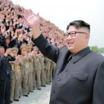 North Korean leader Kim Jong Un waves as he participates in a photo session with officials who are committed to the success of the test-fire of surface-to-surface medium long-range strategic ballistic missile Hwasong-10, in this undated photo released by North Korea's Korean Central News Agency (KCNA) June 28, 2016. REUTERS/KCNA ATTENTION EDITORS - THIS PICTURE WAS PROVIDED BY A THIRD PARTY. REUTERS IS UNABLE TO INDEPENDENTLY VERIFY THE AUTHENTICITY, CONTENT, LOCATION OR DATE OF THIS IMAGE. FOR EDITORIAL USE ONLY. NO THIRD PARTY SALES. SOUTH KOREA OUT. THIS PICTURE IS DISTRIBUTED EXACTLY AS RECEIVED BY REUTERS, AS A SERVICE TO CLIENTS.      TPX IMAGES OF THE DAY