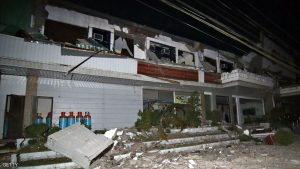 Debris litter next to a destroyed hotel after a 6.5-magnitude earthquake struck overnight in Surigao City, in southern island of Mindanao, early February 11, 2017. A strong quake shook the southern Philippines on February 10, killing at least three people, toppling buildings and sending panicked residents fleeing their homes, media reports and authorities said. / AFP / ERWIN MASCARINAS (Photo credit should read ERWIN MASCARINAS/AFP/Getty Images)