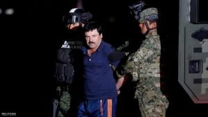 "FILE PHOTO - Joaquin ""El Chapo"" Guzman is escorted by soldiers during a presentation in Mexico City, January 8, 2016. REUTERS/Tomas Bravo"