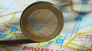 BERLIN, GERMANY - DECEMBER 09:  In this photo illustration a one Euro coin stands on a map of Brussels on December 9, 2011 in Berlin, Germany. Leaders of the European Union convended in Brussels the day before in an effort to finalize joint measures to stabilize the Euro amidst speculation that the common currency can no longer survive in its current form.  (Photo Illustration by Sean Gallup/Getty Images)