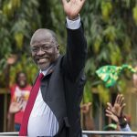 Tanzania's President-elect John Magufuli waves as he leaves after the official election announcement ceremony in Dar es Salaam October 30, 2015. Ruling party candidate John Magufuli won Tanzania's hotly contested presidential elections with over 58 percent of votes, cementing the long-running Chama Cha Mapinduzi (CCM) party's firm grip on power, officials announced on October 29. AFP PHOTO / DANIEL HAYDUK        (Photo credit should read Daniel Hayduk/AFP/Getty Images)