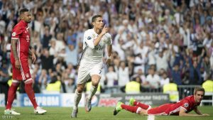 Real Madrid's Portuguese forward Cristiano Ronaldo celebrates scoring during the UEFA Champions League quarter-final second leg football match Real Madrid vs FC Bayern Munich at the Santiago Bernabeu stadium in Madrid in Madrid on April 18, 2017. / AFP PHOTO / CURTO DE LA TORRE        (Photo credit should read CURTO DE LA TORRE/AFP/Getty Images)
