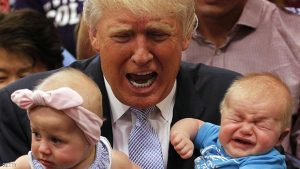 COLORADO SPRINGS, CO - JULY 29: Republican presidential nominee Donald Trump reacts to the cries of three-month-old Kellen Campbell, of Denver, right, while holding six-month-old Evelyn Keane, of Castel Rock, Colo., after Trump's speech at the Gallogly Event Center on the campus of the University of Colorado on July 29, 2016 in Colorado Springs, Colorado. (Photo by Joe Mahoney/Getty Images)