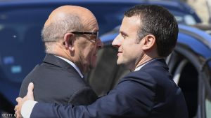 French president-elect Emmanuel Macron (R) embraces President of the Brittany region and outgoing French Defence minister Jean-Yves Le Drian, upon their arrival to attend the funeral ceremony of French socialist lawmaker Corinne Erhel, at the Saint-Jean-du-Baly church in Lannion, western France, on May 10, 2017. Corinne Erhel, 50, died on May 5, 2017, after she spoke during a campaign meeting for French presidential election candidate for the En Marche ! movement Emmanuel Macron. / AFP PHOTO / Damien MEYER        (Photo credit should read DAMIEN MEYER/AFP/Getty Images)