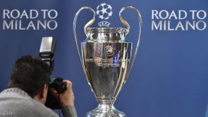 A photographer takes photos of the UEFA Champions League trophy prior the semi-final draw for the UEFA Champions League, on April 15, 2016 at the UEFA headquarters in Nyon.   AFP PHOTO / FABRICE COFFRINI / AFP / FABRICE COFFRINI        (Photo credit should read FABRICE COFFRINI/AFP/Getty Images)