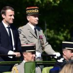 French President Emmanuel Macron (L) and Chief of the Defence Staff, French Army General Pierre de Villiers ride aboard a command car during the annual Bastille Day military parade on the Champs-Elysees avenue in Paris on July 14, 2017. The parade on Paris's Champs-Elysees will commemorate the centenary of the US entering WWI and will feature horses, helicopters, planes and troops. / AFP PHOTO / POOL / CHRISTOPHE ARCHAMBAULT        (Photo credit should read CHRISTOPHE ARCHAMBAULT/AFP/Getty Images)