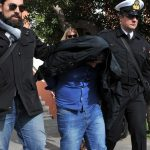 Policemen escort to the Alexandroupolis courthouse one of the three Britons arrested near the border with Turkey where they were suspected of heading to join Kurdish forces fighting Islamic State jihadists, northern Greece ,on February 16, 2016.  One of the three, a 40-year-old said to be of Kurdish Iraqi origin, had four firearms and 200,000 rounds in his possession when he was picked up at the Kipi border post on the Evros River which borders the two nations.  / AFP / SAKIS MITROLIDIS        (Photo credit should read SAKIS MITROLIDIS/AFP/Getty Images)