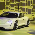 The new electric Porsche Mission E concept car is presented during the Volkswagen group night at the Fraport arena prior to the 66th IAA auto show in Frankfurt am Main, Western Germany, on September 14, 2015. Volkswagen group showed their latest models  and automotive concepts from the brands Volkswagen, Audi, Bentley, Bugatti, Ducati, Lamborghini, Porsche, Seat and Skoda. Hundreds of thousands of visitors are expected to crowd into the massive exhibition halls of Frankfurt's sprawling trade fair grounds later this week  to catch a glimpse of the latest models and high tech innovations.   AFP PHOTO / ODD ANDERSEN        (Photo credit should read ODD ANDERSEN/AFP/Getty Images)