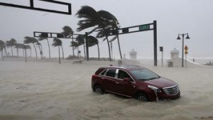 FORT LAUDERDALE, FL - SEPTEMBER 10: A car sits abandoned in storm surge along North Fort Lauderdale Beach Boulevard as Hurricane Irma hits the southern part of the state September 10, 2017 in Fort Lauderdale, Florida. The powerful hurricane made landfall in the United States in the Florida Keys at 9:10 a.m. after raking across the north coast of Cuba. (Photo by Chip Somodevilla/Getty Images)