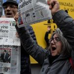 ISTANBUL, TURKEY - OCTOBER 31:  People protest outside the Cumhuriyet Newspaper office after thirteen journalists including the editor-in chief were arrested on October 31, 2016 in Istanbul, Turkey. The Turkish prosecutors office has accused the journalists of helping the PKK and the Gulenist terror organisation.  The opposition newspaper is  Turkey's oldest broadsheet newspaper.  (Photo by Chris McGrath/Getty Images)