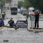 Residents who refused to be evacuated sit on makeshift boats during evacuation operations of the Villeneuve-Trillage flooded suburb in Villeneuve Saint-Georges, outside Paris, France, June 3, 2016 after days of almost non-stop rain caused flooding in the country. REUTERS/Christian Hartmann
